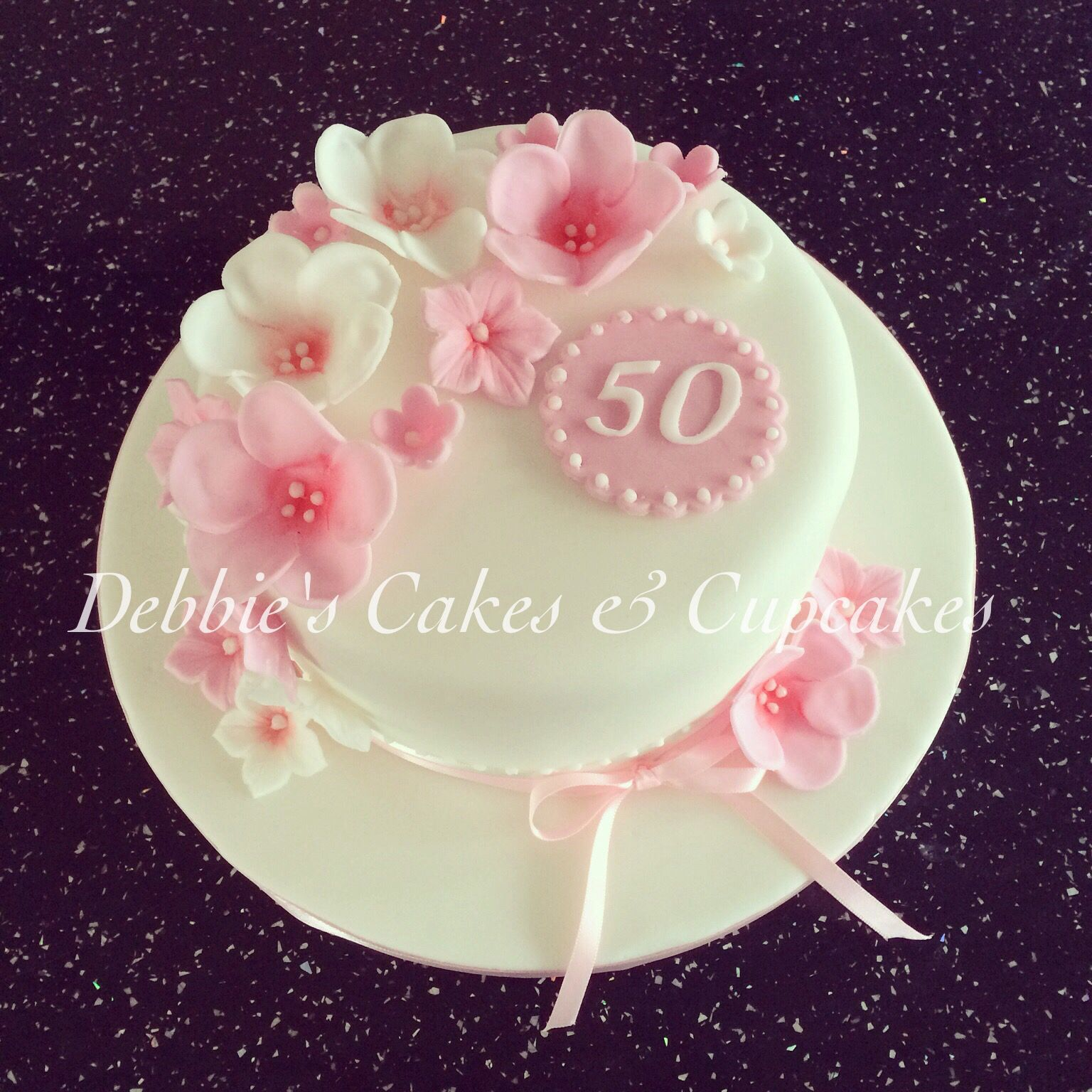 50th birthday cake, with pink and white flowers