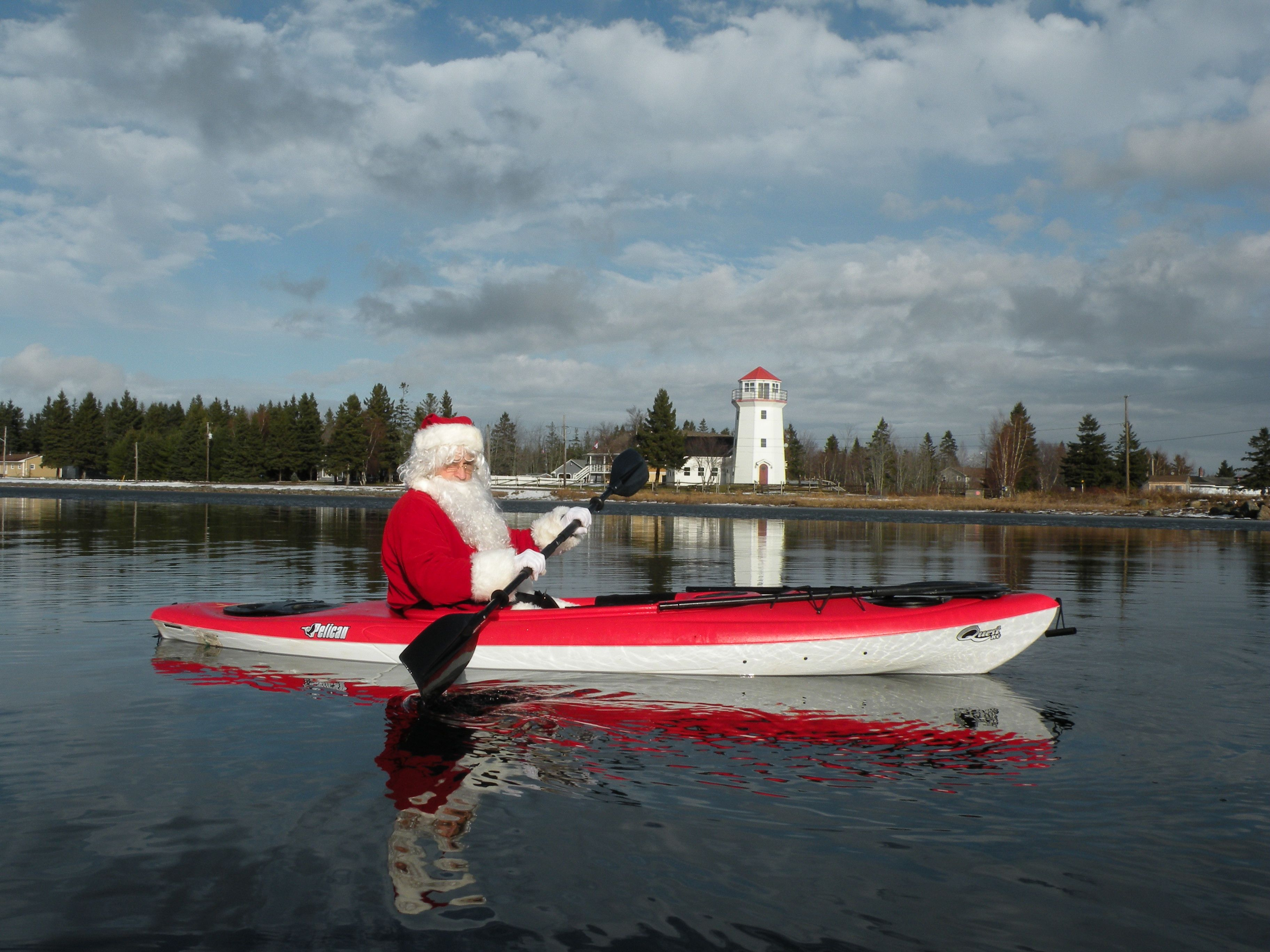 Santa kayaking in Richibucto-Village, New Brunswick, Canada on Dec 22, 2012. I great way to relax before the big night.