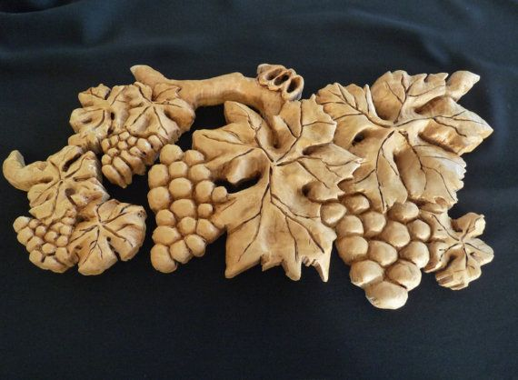 Organic hand carved grapes and leaves wooden sculpture