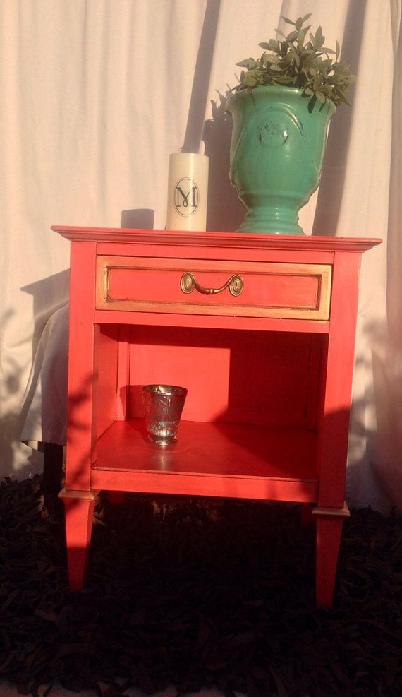 Coral is the new Orange nightstand. Love this color with gold highlights and sealed in wax. Has a lined drawer and bottom shelf. The perfect pop