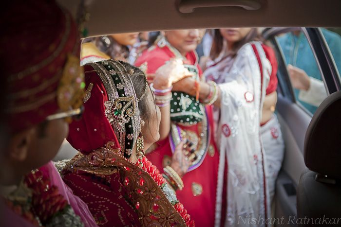 an indian bride bids farewell to her mother as the latter is pulled