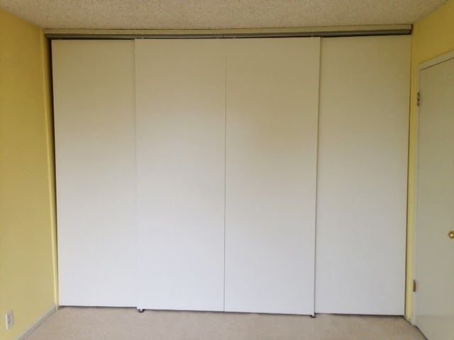 sliding doors across wide space using track hardware from