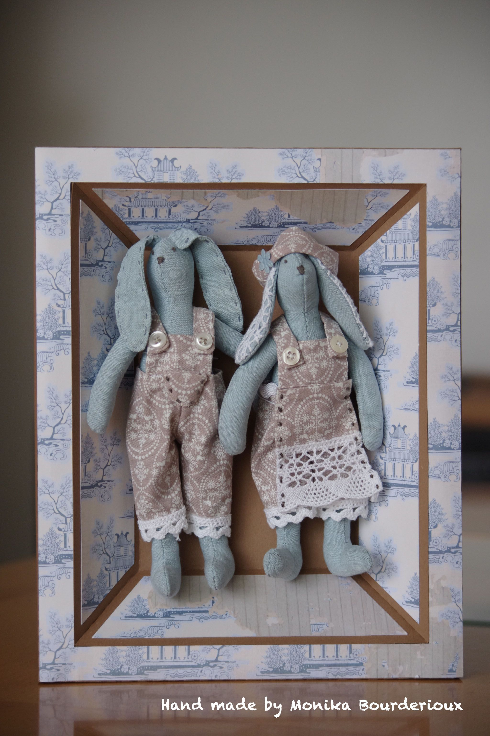 Wall's paper frame with hand made Tilda dolls