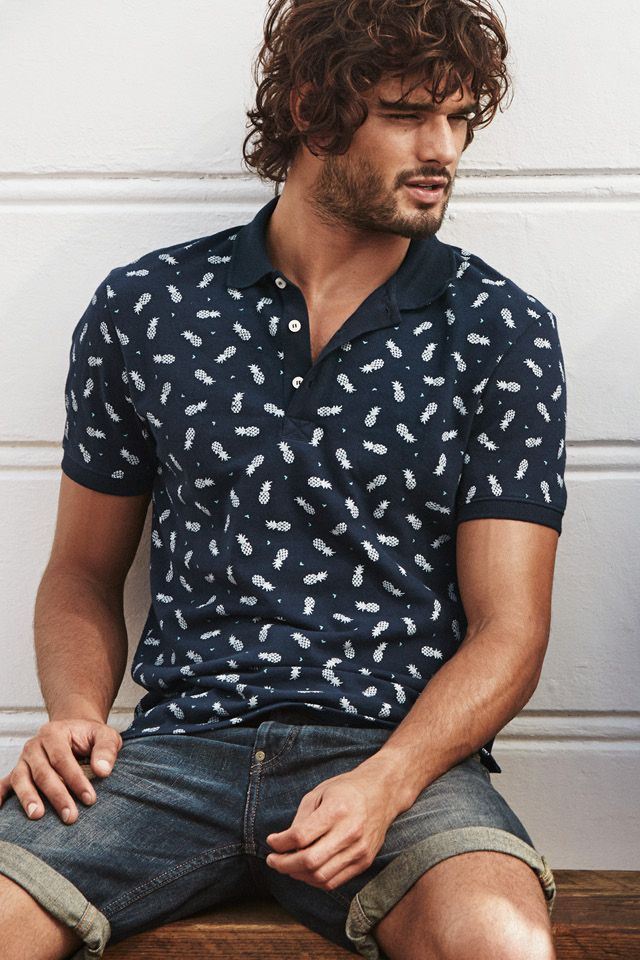 697f26376aa Navy blue short-sleeved collared shirt with a fresh pineapple print ...
