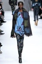 Issey Miyake fall '12 bright print with puffy scarf and fishnet inspired leggings