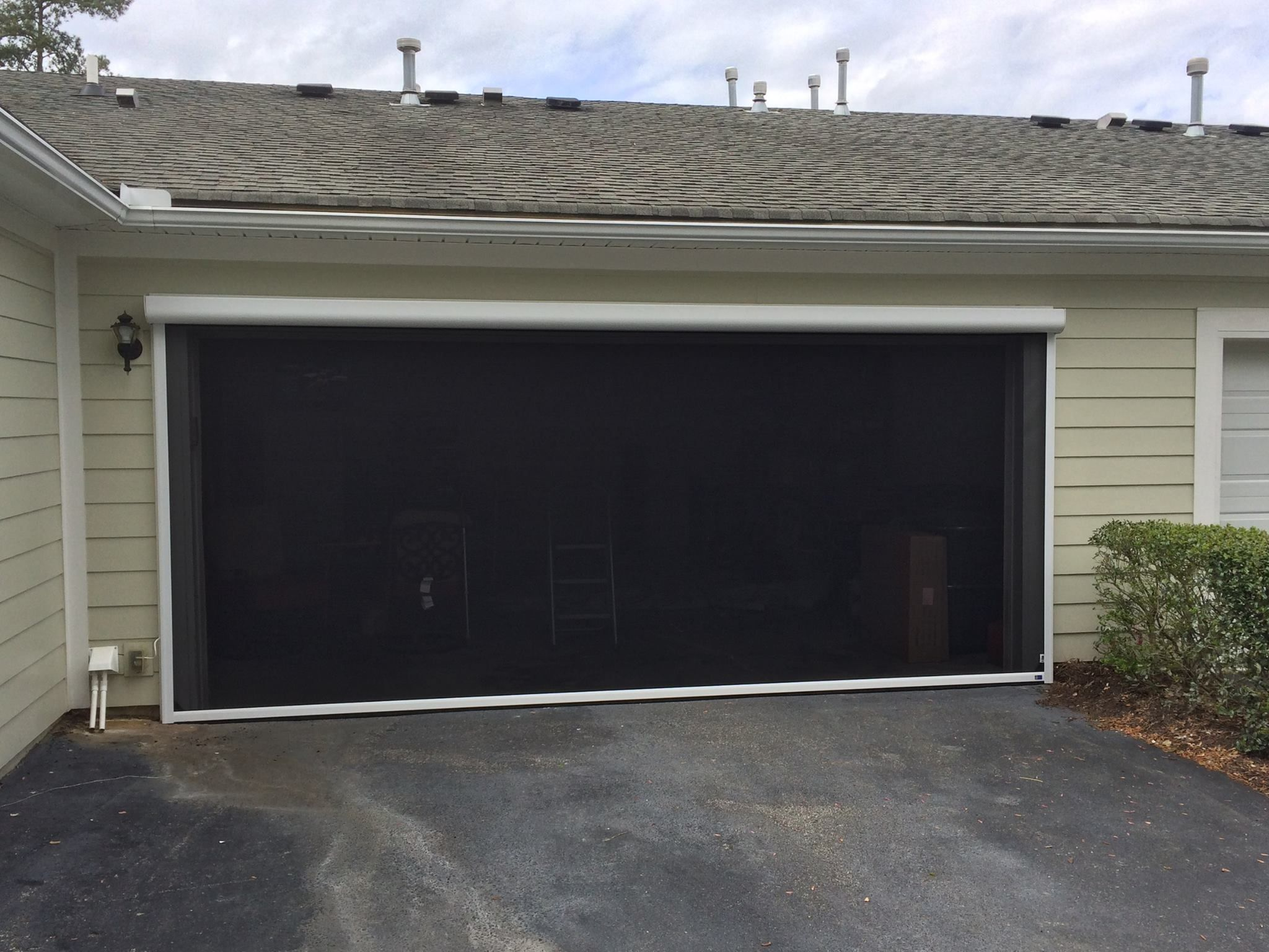 Turn Your Garage Into A Man Cave By Adding A Motorized Bug Screen Or Privacy Screen Bug Screen Screen Door Garage