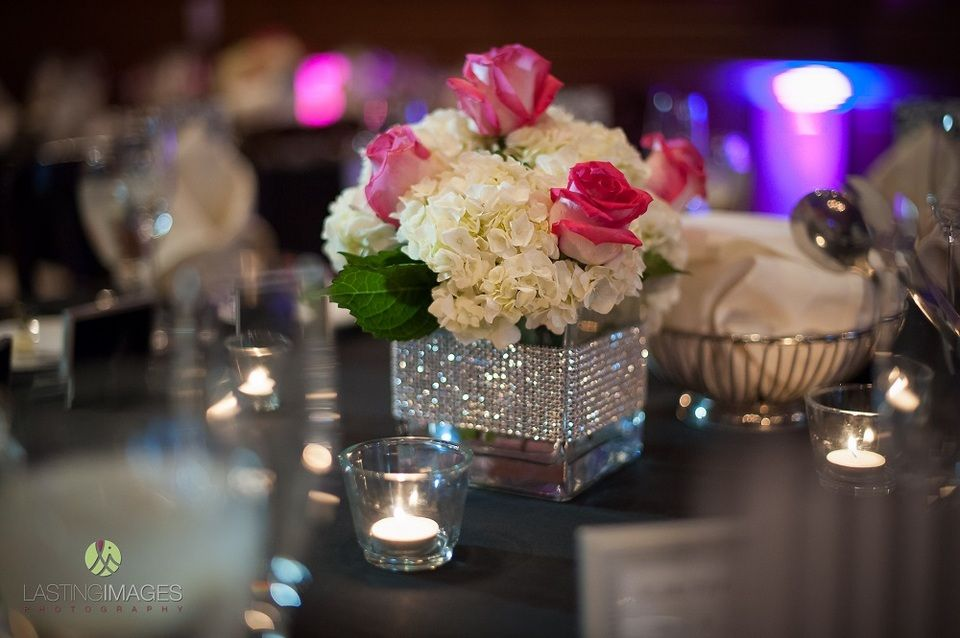 Low centerpiece floral arrangement square glass vase