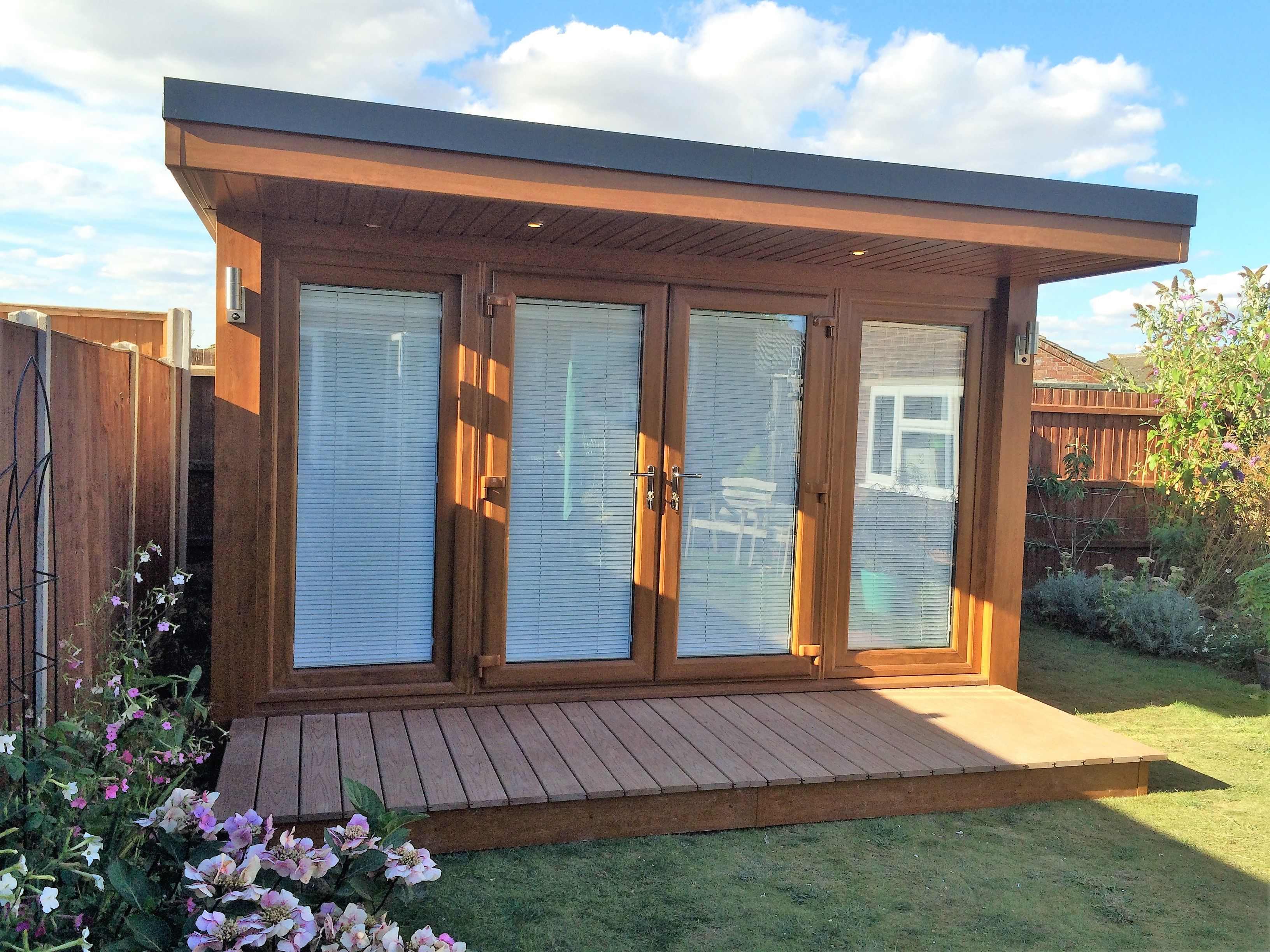 Oak garden office with flyover roof and composite deck for Oak garden office