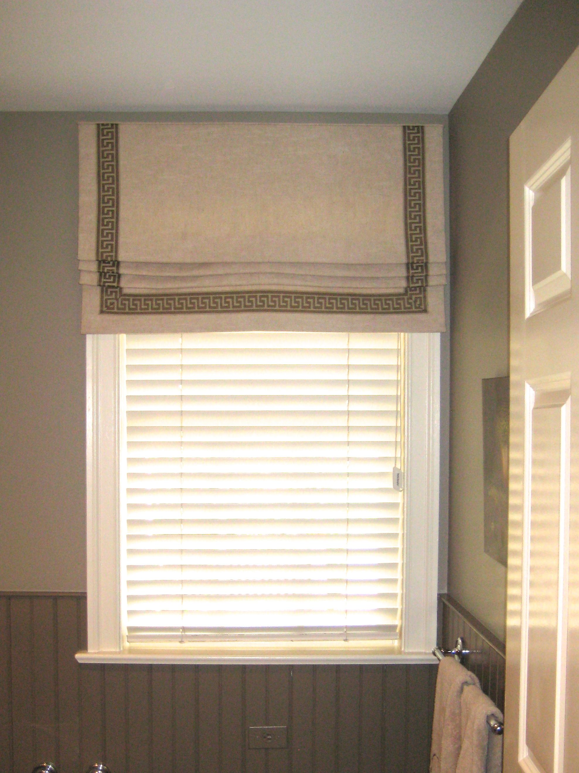 Tape Trim Adds An Elegant Border To This Roman Shade