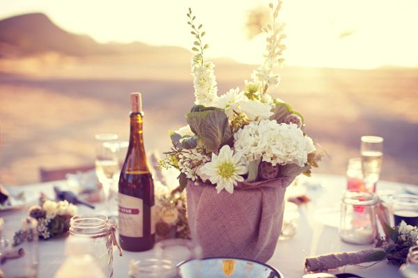 What a great way to use burlap, covered pots with mason jars filled with sand for rehearsal dinner tables