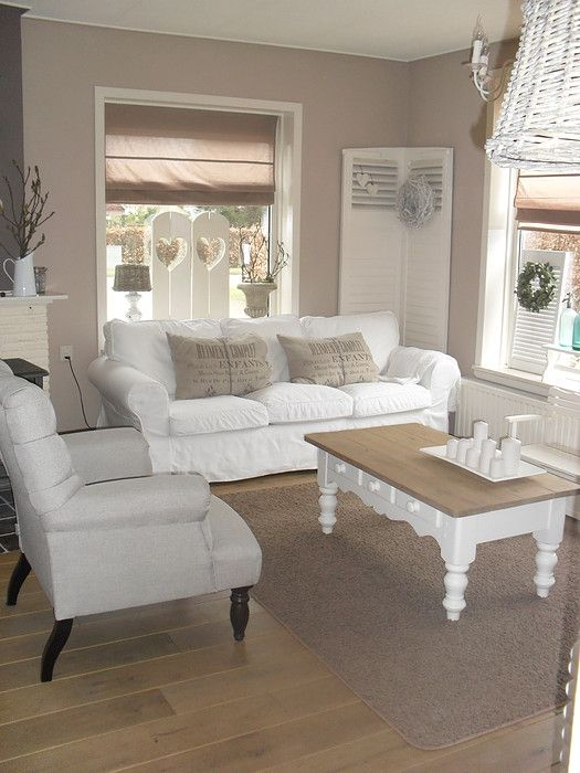 neutral air living room space and I am in love with this coffee table
