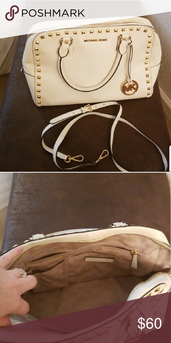 61dedb44731c Michael kors white purse In good but used condition. Leather has mild  cracking and inside is not pristine but no rips. Michael Kors Bags Totes
