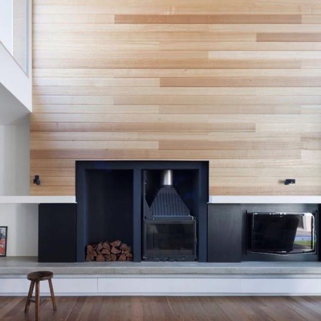 Fire place with wooden wall