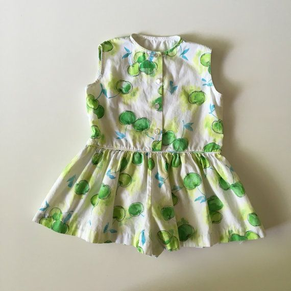 Vintage Handmade Toddler Girl Sunsuit Romper with Green Apple Print Skort for sale here https://www.etsy.com/listing/458275446/vintage-handmade-cotton-shorts-romper?ref=shop_home_feat_2 #vintage #baby #vintagebaby #vintagebabyclothes #vintagestyle #vintagebabystyle #vintageclothes #vintagetoddler #vintageromper #vintagetoddlerclothes
