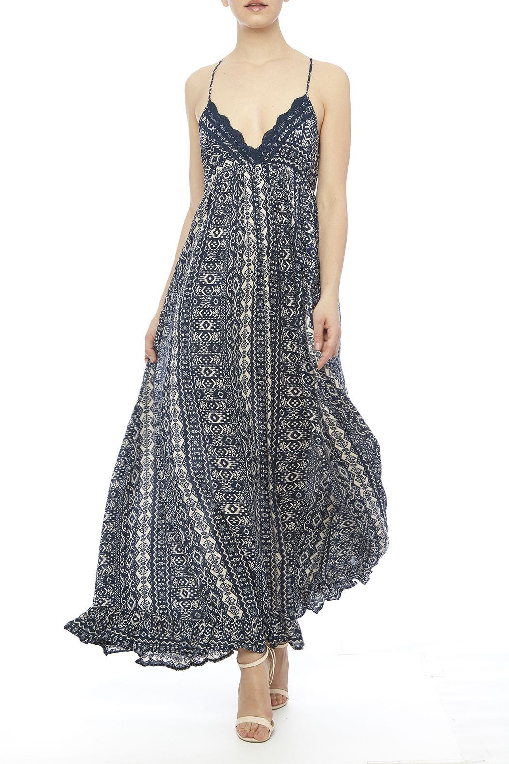 Navy patterned,boho sundress with a ruffle hem and lace embellishment at the v-neckline.   The Mary Dress by Cotton Candy. Clothing - Dresses - Maxi Clothing - Dresses - Printed Minneapolis, Minnesota