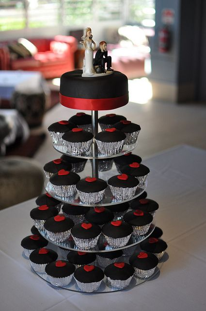 Still able to use a cake topper and have a small cake on top for a ceremonial cake cutting - good idea!