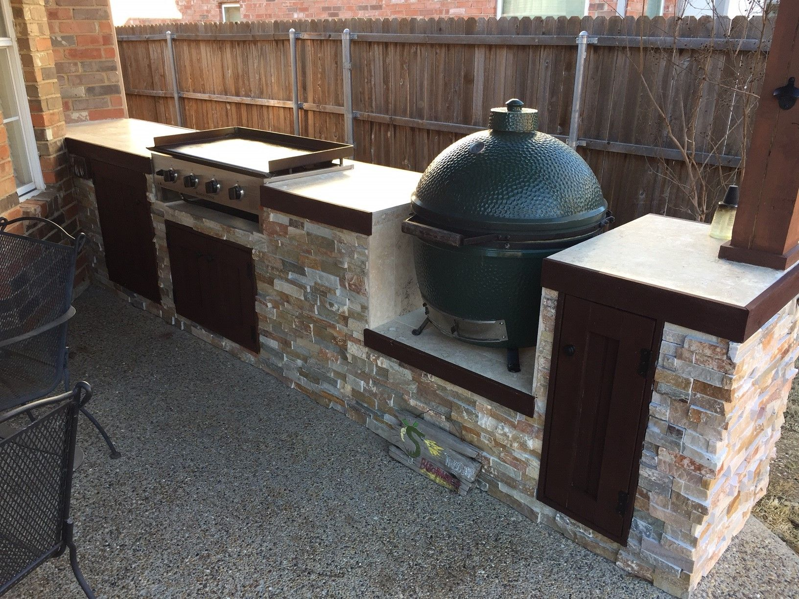 It was a bit of a drawn out process, but the outdoor kitchen & covered patio project that started before Thanksgiving is finally done!
