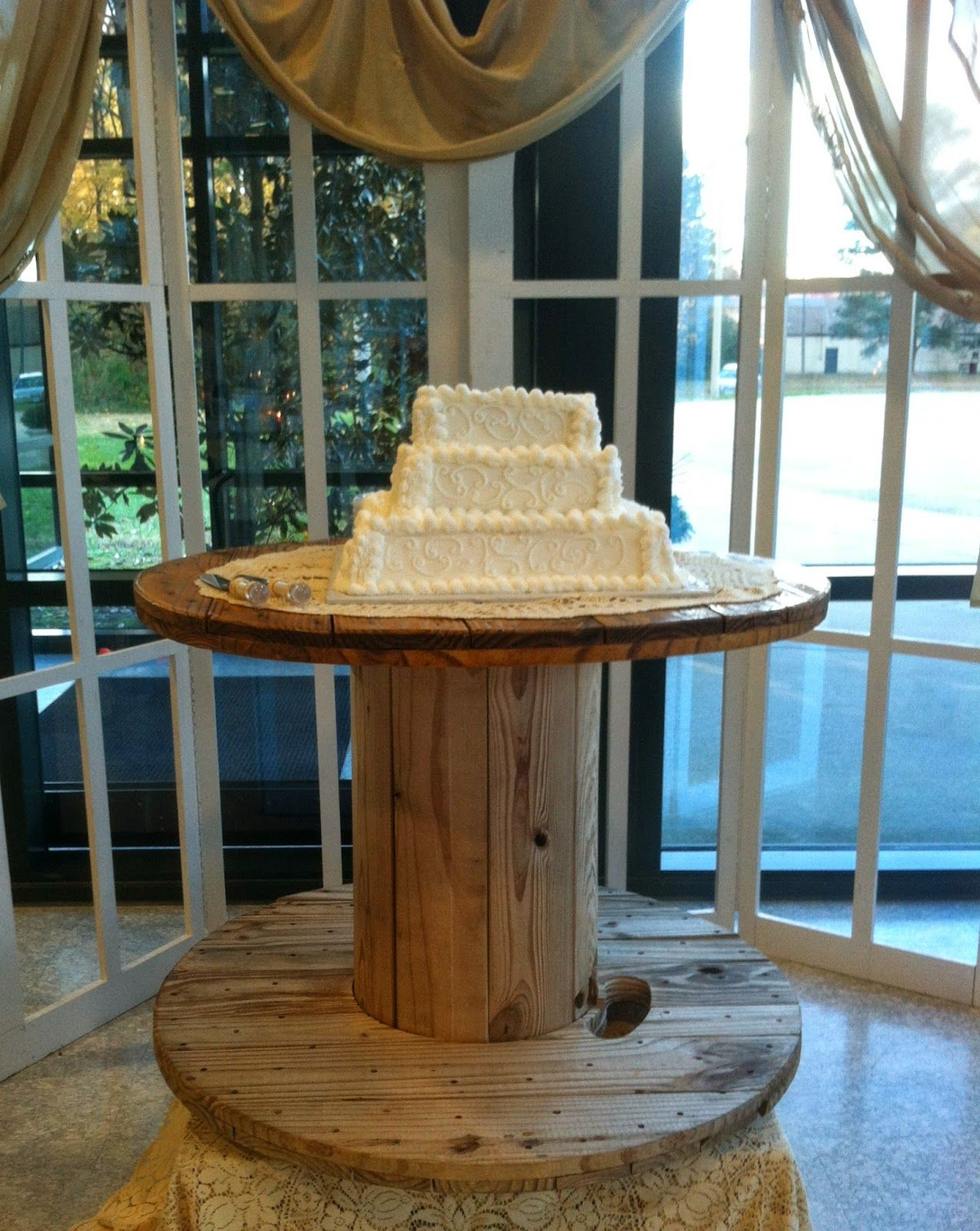 Wooden spool table as the cake table/Rustic wedding