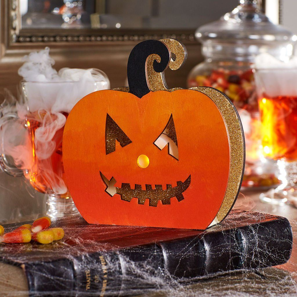 Make this easy DIY Glitter LED Wood Pumpkin to decorate for - Decorate For Halloween