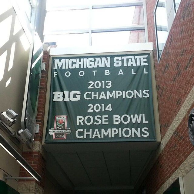 A new banner, celebrating MSU's 2013 Big Ten/2014 Rose Bowl Championships, is now on display in Skandalaris Center. #msufootball #spartans #Padgram
