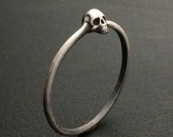 This dainty sterling silver skull is great layer stacking with other rings. It will add a little edge to the rest of your collection.
