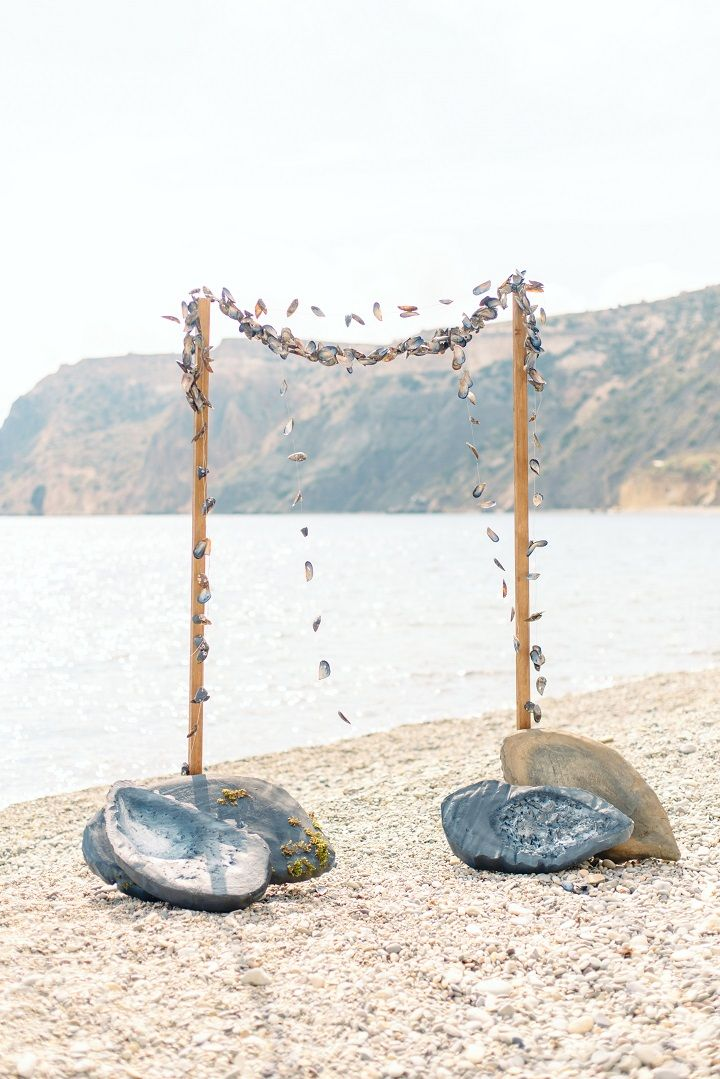 Garlands of mussel shells are a lovely nautical touch | fabmood.com #weddingarbor #beachweddingarch #beachweddingdecor #beachwedding