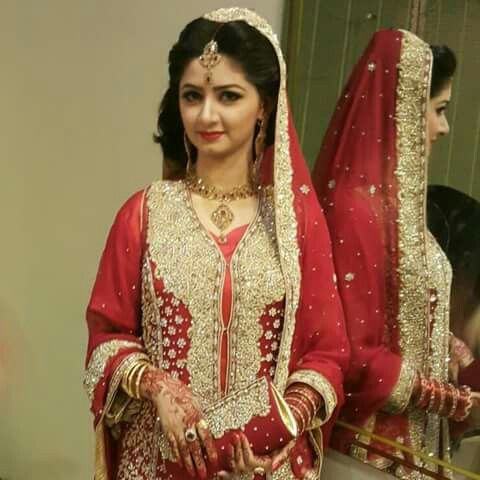 Beautiful pakistani bride in red lehnga.. Looking gorgeous