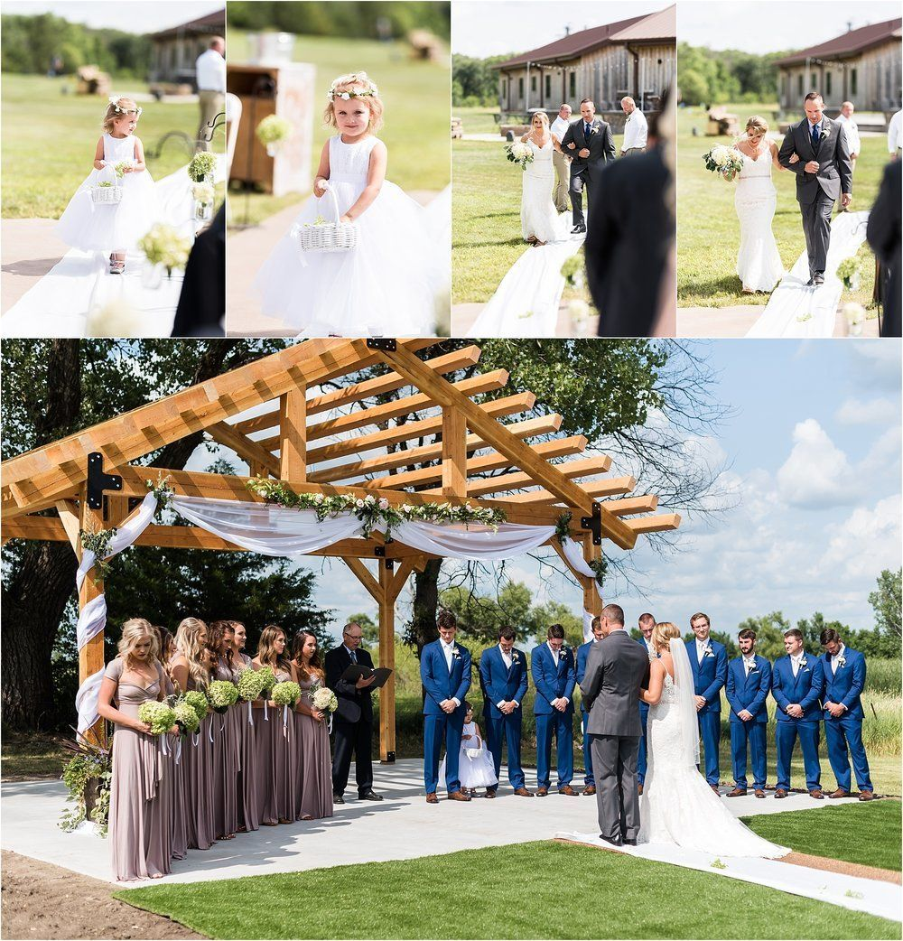 Outdoor wedding ceremony under trellis with bride down the aisle