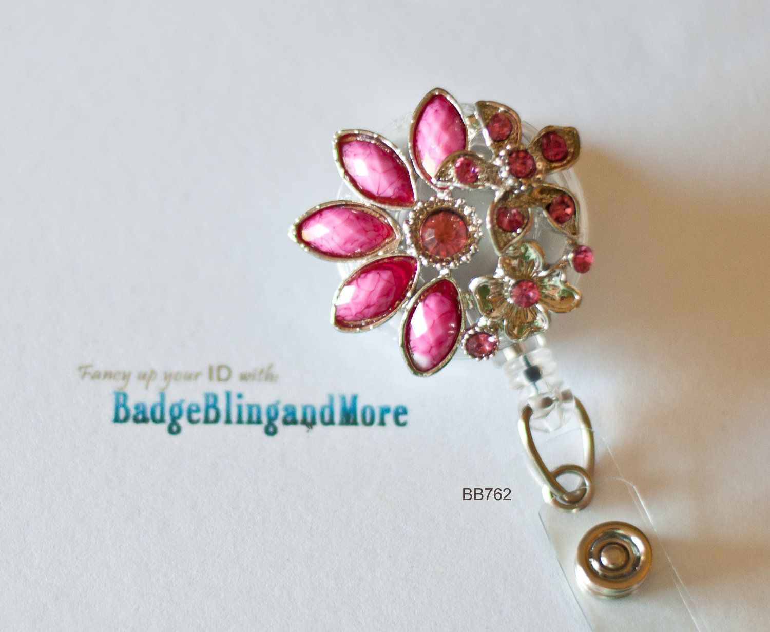 Cute Half Flower with Flower accents in Pretty Pink -(clear)RETRACTABLE /Swivel Reel/Spring Clip - Badge Holder BB762. $12.00, via Etsy.