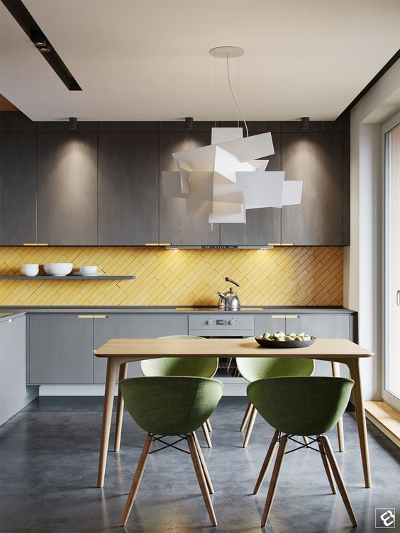 A minimalist moody grey kitchen with a sunny yellow tile clad in a diagonal way dream home pinterest gray kitchens yellow kitchen decor and