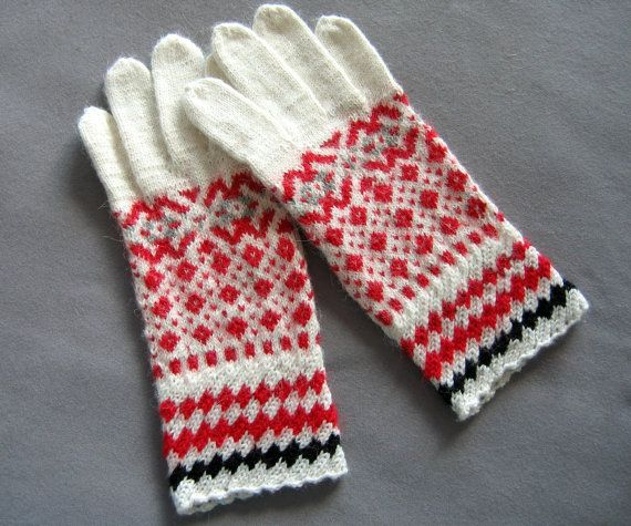Hand knit gloves. Khitted gloves. White, red and black gloves ...