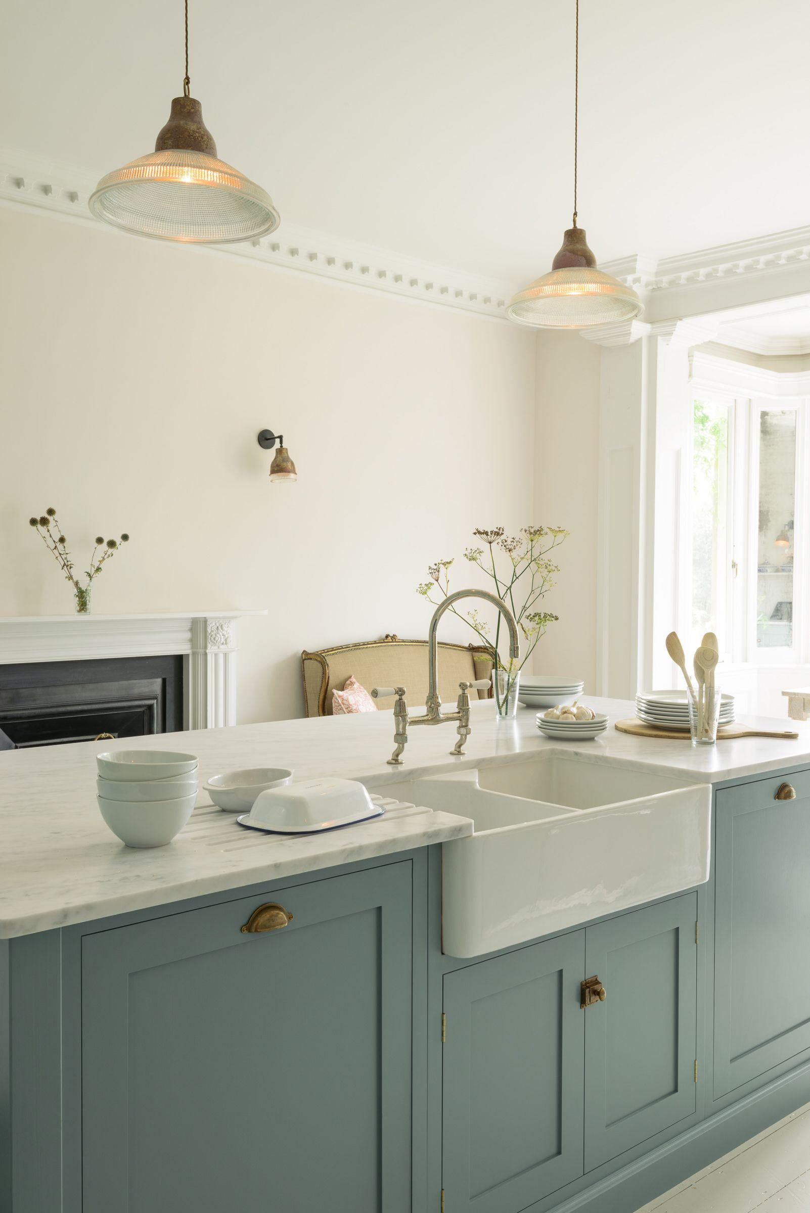 Honed Carrara marble worktops, a huge double Belfast sink, chrome ...