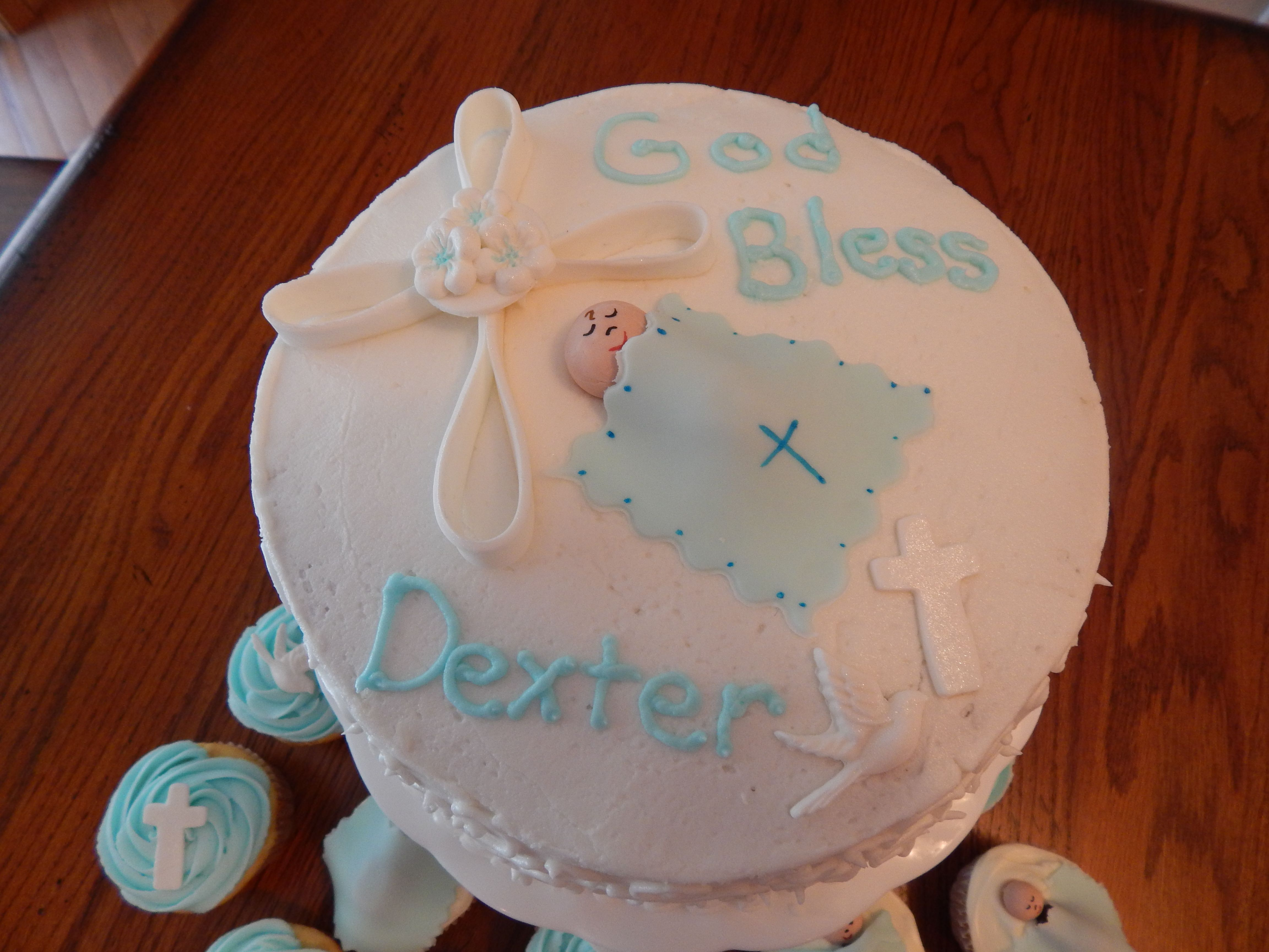 Dexter's baptism cake.  Fondant/gum paste cross. gum paste head, markers for face. cutter for cross and mold for dove.