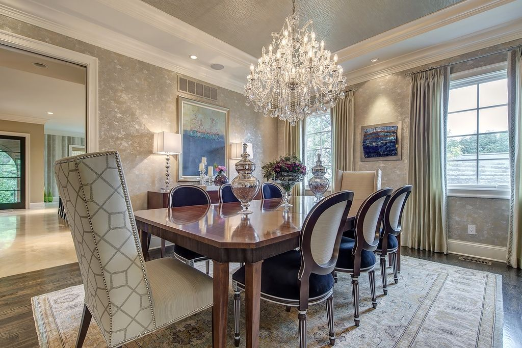 Traditional Dining Room With Crown Molding Elegant Lighting Maria Theresa 19 Light Chandelier Wallpaper Wood Table
