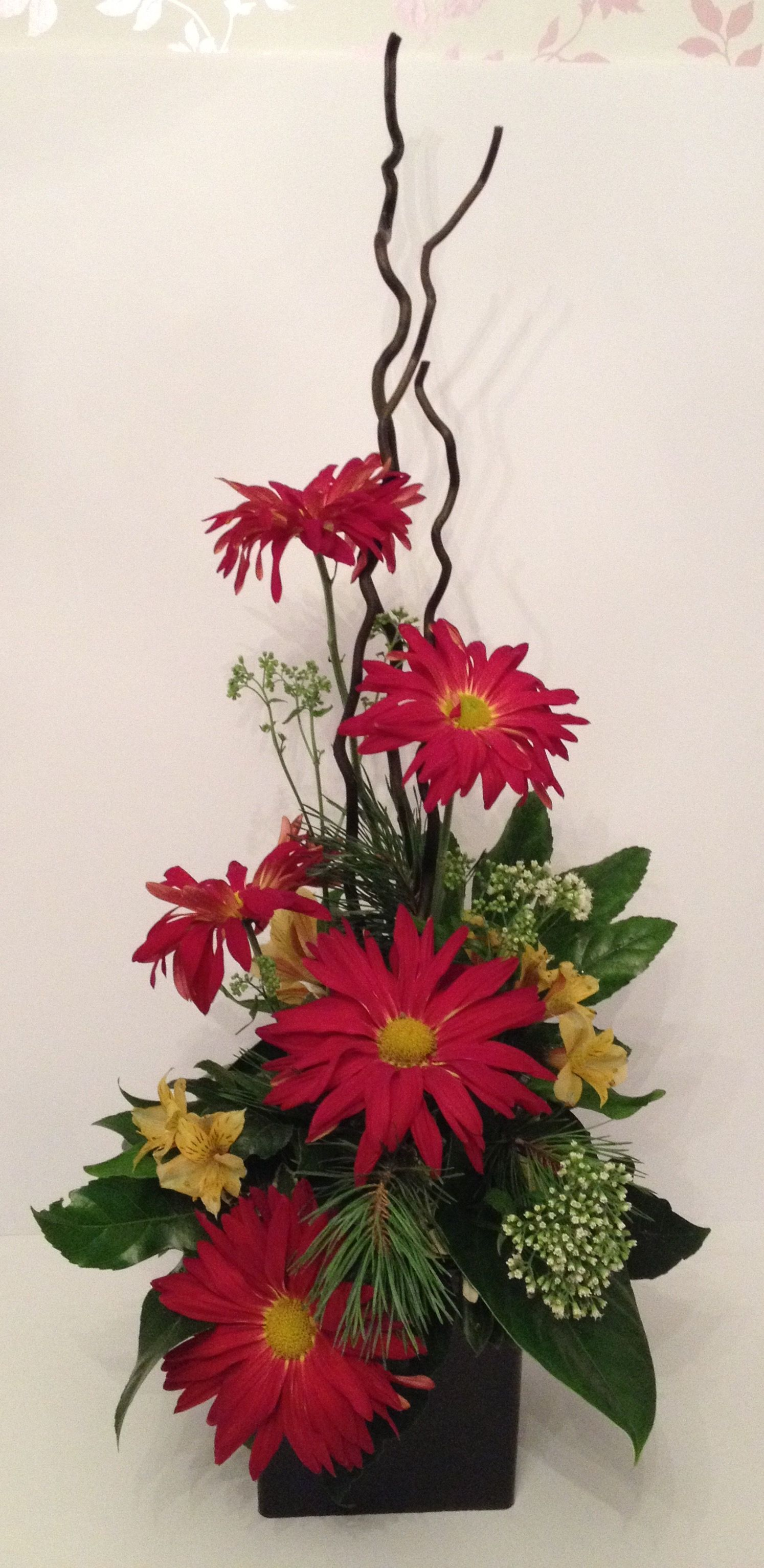 Large contemporary vertical flower arrangement design with