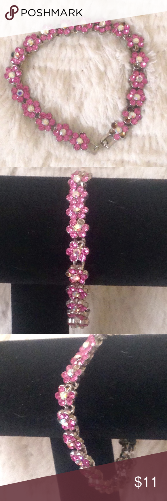"""Antique pink rhinestone flower bracelet For being an antique this perfect is in very good condition. It's Missing a couple of rhinestones but the silver tone base the stones are set in is in great condition. The closure of the bracelet is a small hook shown in pictures.   Approximately 7"""" in length  🛑 No trades or lowball offers 👎🏻 My closet items aren't for personal profit, are already extremely discounted and sell very fast. So if you see things you 😍 ♥️, make an offer!  🎀 Free gift…"""