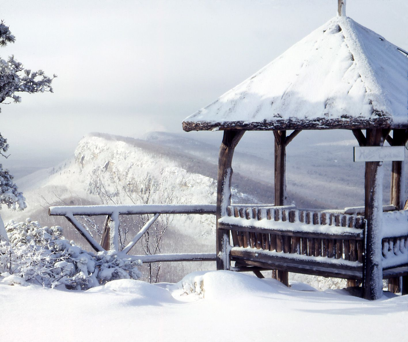 Snow covered gazebo in the winter at Mohonk overlooking the Trapps.