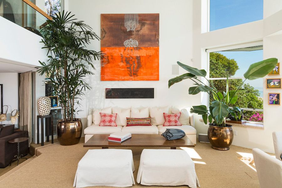 http://sandavy.com/marvelous-masterfully-crafted-paradise-cove-beach-house-design-in-malibu/wooden-flooring-brown-flooring-brown-cozy-sofa-living-room-design-ideas-modern-interior-design-ideas-abstract-wallpaper-modern-living-room-oriental-decor-white-comfy-sofa-glass-window-white-wall-cushi/