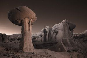 An infrared image at dusk of strange clay rock formations in Ah-Shi-Sle-Pah Wilderness in Farmington, New Mexico