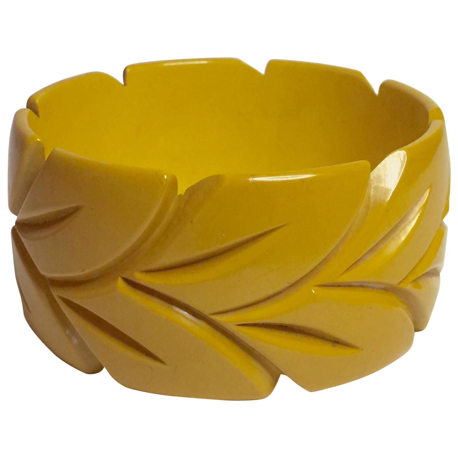 1930's Cream Bakelite Carved Bangle Bracelet Stylized Leaf | From a unique collection of vintage bangles at https://www.1stdibs.com/jewelry/bracelets/bangles/