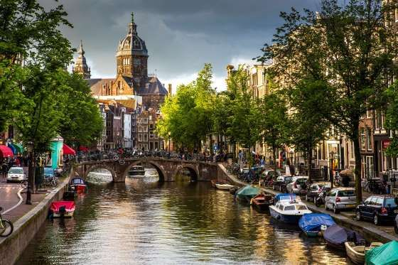 Church of St Nicholas and canal in Amsterdam - Richard I'Anson/Lonely Planet/Getty Images
