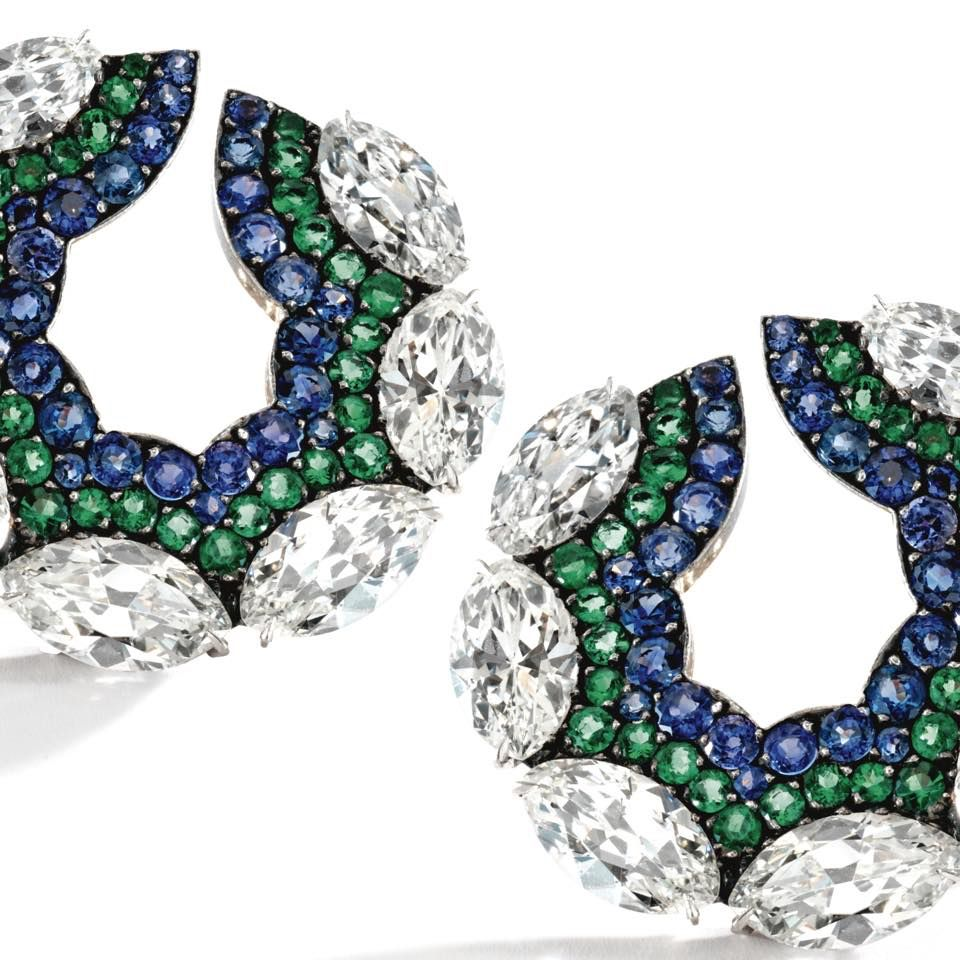PAIR OF 18 KARAT GOLD, SILVER, DIAMOND, SAPPHIRE AND EMERALD EARCLIPS, JAR PARIS, 1998. The stylized hoops set with marquise-shaped diamonds weighing approximately 8.50 carats, accented by round sapphires and emeralds, maker's marks. Estimate 100,000 - 200,000 USD / LOT SOLD 326,500 USD [S. MAGNIFICENT JEWELS - 14 APRIL 2011 - NEW YORK] #JAR #JARParis #JoelArthurRosenthal