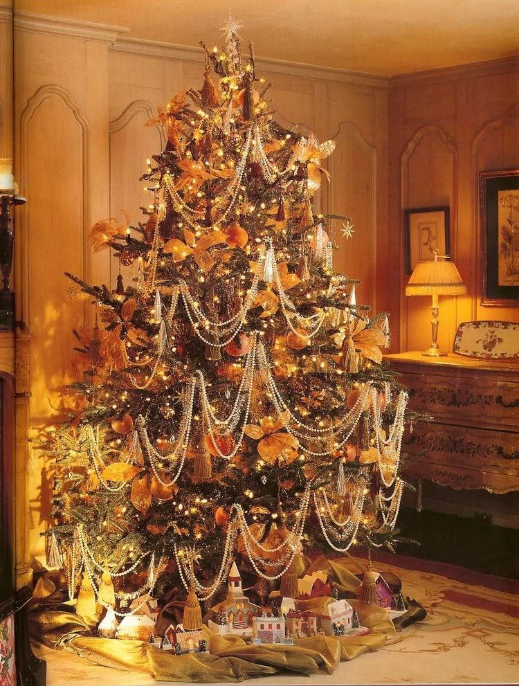 Balsam fir Christmas tree with faux pearl bead garlands double swags  interspersed w/garlands of lametta tinsel. Glass globes, gilded faux  leaves, ... - Balsam Fir Christmas Tree With Faux Pearl Bead Garlands Double Swags