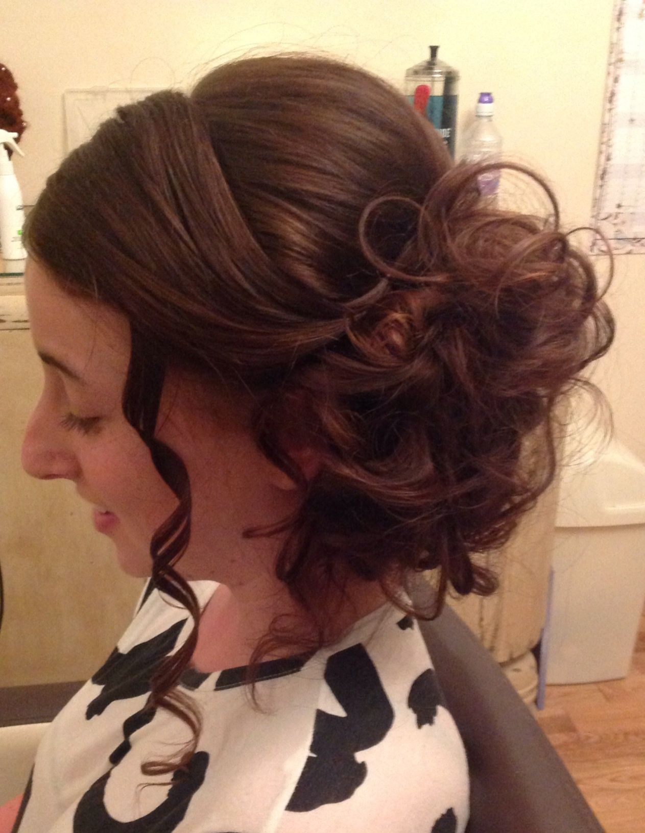 Messy curled side bun wedding hair style
