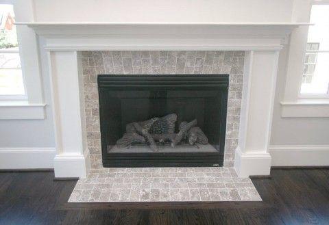 3x6 Walnut Travertine Laid Like Brick Around Gas Insert Fireplace