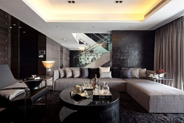 luxus wohnzimmer dunkle farben graues sofa dekokissen rundtisch ...