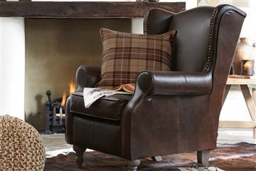 Sherlock Leather Armchair With A Stag Head Cushion Living Room