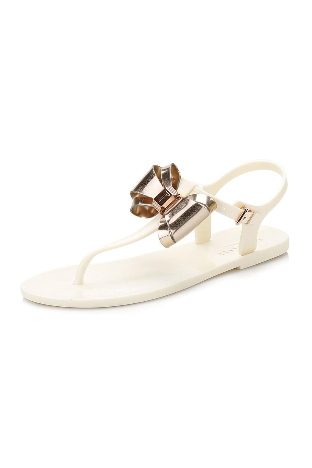 898ae83572b4 This pretty Ainda bow detail toe post flat sandal is great for sunny days.  Showcasing a statement layered bow trim with brand detailing.