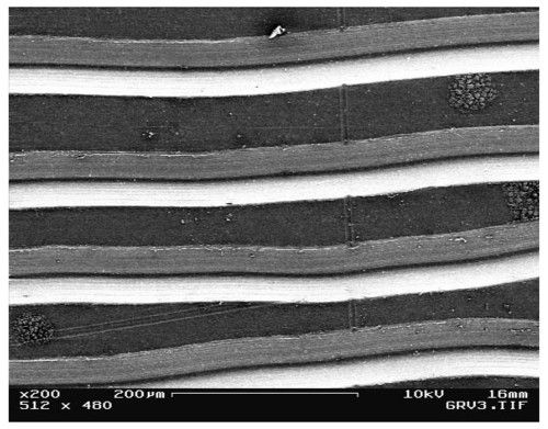 Vinyl record grooves under electron microscope - Reckon | sound