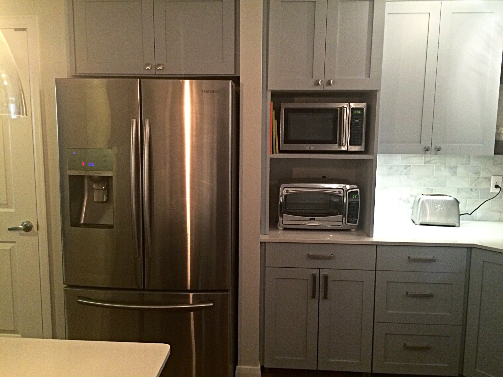 Custom Shaker Style Cabinets Accented By Chipped Ice Quartz